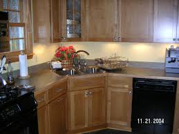 kitchen sink and faucet ideas modest kitchen design with l shaped cabinet featuring undermount