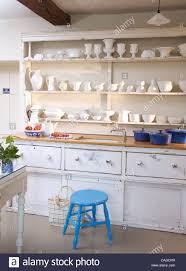 Shelf Above Kitchen Sink by White China Displayed On Shelves Above Sink In White Built In