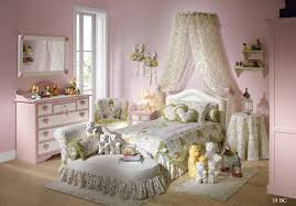 girls white bedding white wooden canopy beds having white curtains with patterned