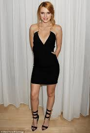 bella thorne steals the show in black dress and strappy heels at