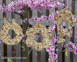 and adults can both make these easy birdseed ornaments garden craft