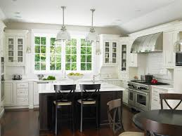 modern chic glam kitchen with large windows by the sink u0026 less