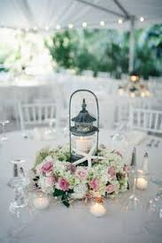 Wedding Centerpiece Lantern by Lantern Centerpieces With Driftwood And White Blush And Lavender
