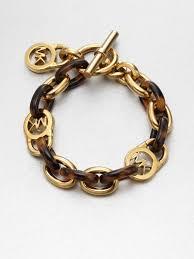 chain link bracelet gold images Lyst michael kors tortoise pattern logo lock chain link bracelet jpeg