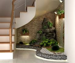 interior garden design ideas if you have an empty space under the stairs in your home then
