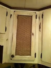 how to put chicken wire on cabinet doors diy cabinet door used burlap and chicken wire for a more rustic look