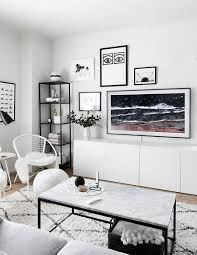 gallery wall update a tv that matches our decor homey oh my this has replaced the previous two bulky remotes we had and i m all for reducing clutter