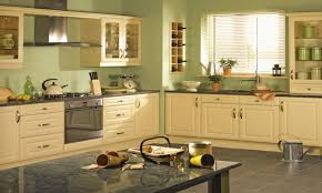 yellow kitchen walls with dark cabinets great home design green and orange kitchen ideas