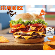 bk halloween whopper burger king spain takes the lazy route throws doritos on top of a