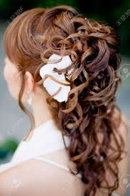 bridal back hairstyle bridal hairstyle with lilly flower in hair back view shallow