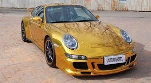 gold porsche 911 porsche 911 4s wrapped in gold luxuo