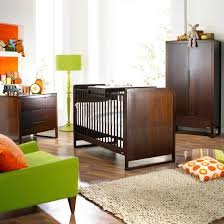 crib and changer combo in bedroom modern with dark wood furniture