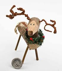 rustic carved wooden reindeer ornament ornaments