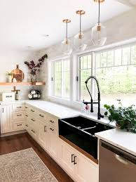 white kitchen cabinets with farm sink designing a modern farmhouse kitchen with a black farmhouse