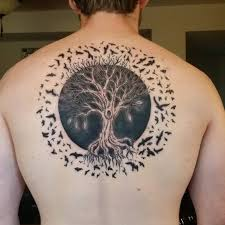 tree of life with a solar eclipse surrounded by birds first
