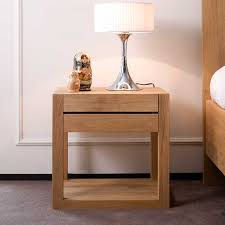 white stained wooden nightstand with flat eased oak wood table top