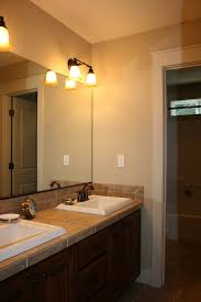 Pendant Lighting Over Bathroom Vanity by Beige Bathroom Design Idea Feat Awesome Frameless Mirror And