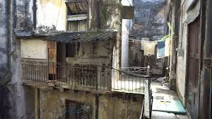 house courtyard inside the courtyard of old battered dirty house in a slum into
