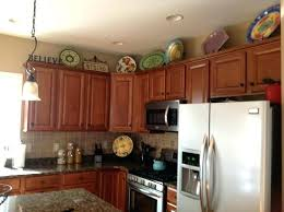 above kitchen cabinet ideas top of cabinet decor cupboard top decorating ideas motauto