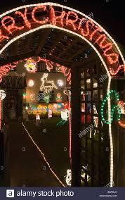 illuminated christmas garden viewed through trellis archway