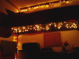 How To Hang Christmas Lights by Put Christmas Lights Under A Lofted Bed To Light Up A Dreary Dorm