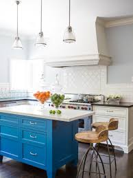 blue kitchen island white kitchen design with blue island and wooden chairs 2436