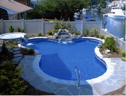 captivating blue water pool alternative with stone grout decking
