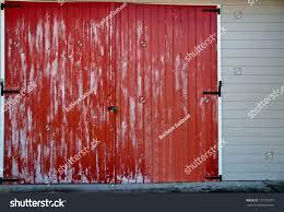 Red Barn Door by Faded Red Barn Door Black Latches Stock Photo 137150273 Shutterstock
