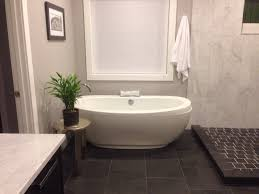 my master bath free standing bath tub with slate floors maax tub