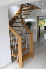 fancy curved modern staircase with wooden frames as space saving