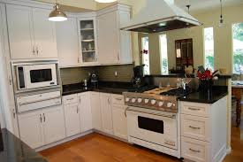 black mahogany cabinet with white marble modern u shaped kitchen