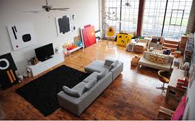 living room black fur rug grey bed sofa laminate flooring