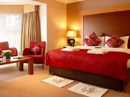 bedroom witching design ideas of modern bedroom color scheme bedroom witching design ideas of modern bedroom color scheme with brown wooden wheeled bed frames and high headboard also white red colors bedding sheets