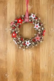 decorated christmas door wreath with red and pillow stars