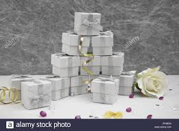 favor ribbons wedding favor boxes on a white tablecloth with gold stock photo