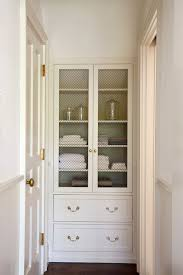 white linen cabinet with doors hallway features built in linen cabinet with chicken wire hutch