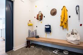 floating wood mudroom bench with staggered hooks contemporary