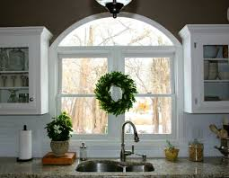 kitchen windows over sink arched window over sink redecorated kitchen hooked on houses