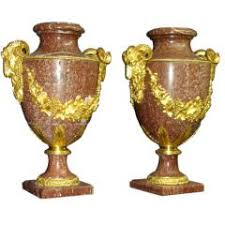 a pair of onyx and silvered bronze ornamental vases for sale