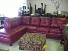 luxutr red faux leather sofa mixed white cushions and chromed