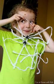 kid made halloween decorations hanging spiderwebs decoration