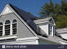 cape cod house solar panel installation on a nice cape cod house with sunny blue