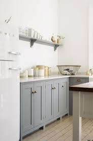beautifully simple devol shaker cupboards with brass door furniture