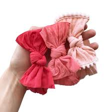 baby bling bows baby bling bows color comparison salmon next to