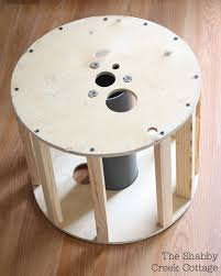 upcycle idea upholstered stool from a cable spool