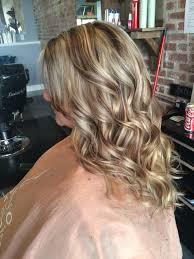 curly hair with lowlights awesome blonde highlight with warm brown lowlights chunky long