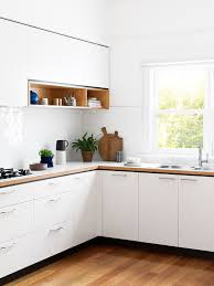 All White Kitchen Designs Modern All White Kitchen With Wood Accents And Flower Inspired