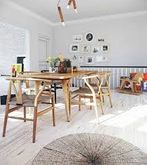 light filled scandinavian dining area with wishbone chairs and