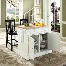 kitchen island with seating and stove kitchen sink black top white