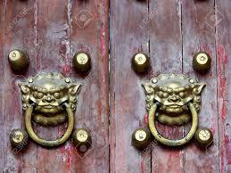 old chinese door ornament lion door knockers stock photo